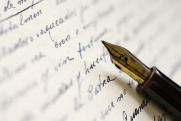 image of fountain pen on a piece of paper which it was used to write on, meant to represent my writing and blogging